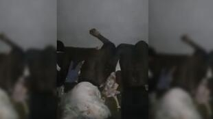 Screengrab of a video that recently emerged, showing a member of a Libyan armed group whipping Sudanese migrants.