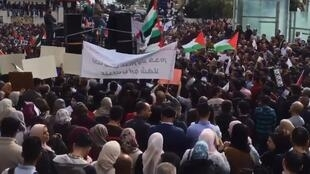 Screen capture from a video that shows a protest in Ramallah against the new social security law.