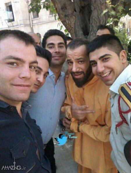 Still wearing handcuffs, singer Amir Tataloo (second from left) poses for a photo with fans during his third trial. Photo: Tataloo's official Instagram account