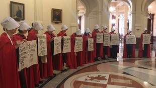 Activists dressed in red cloaks protest silently in Texas's state Capitol. Photo: @SophieNovack on Twitter.