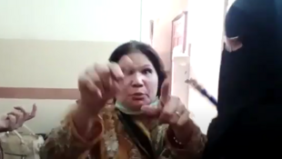 Surrounded by her attackers, at least two of whom are wearing burqas, Nazir Gill responds to her accusers by saying that she is Christian and that she has not spoken against Islam. This video was circulating on social media in the days after the event.