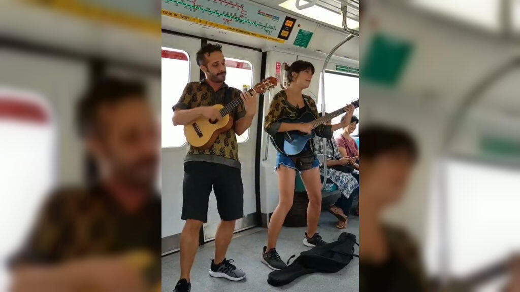 A video of a pair of Westerners busking on the subway in Singapore quickly drew backlash from locals. (Photo: Twitter)