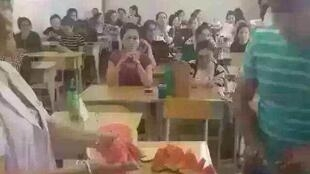 Professors at the University of Medicine in Urumqi, Xinjiang, hand out melons to Uighur students during Ramadan. Photo uploaded to the private Wechat account of our Observer, Lin (not his real name).