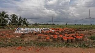 Dozens of baskets of rotten tomatoes were abandoned by the side of the road in Grand-Popo, Benin. (Photo posted on Facebook by Yanick Folly).