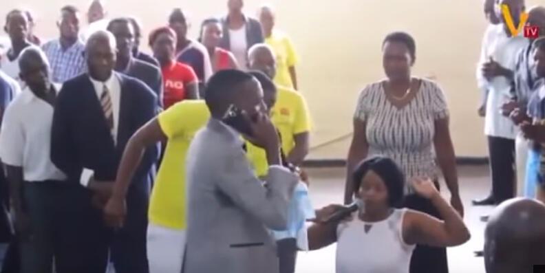 Paul Sanyangore talks to God on the telephone.