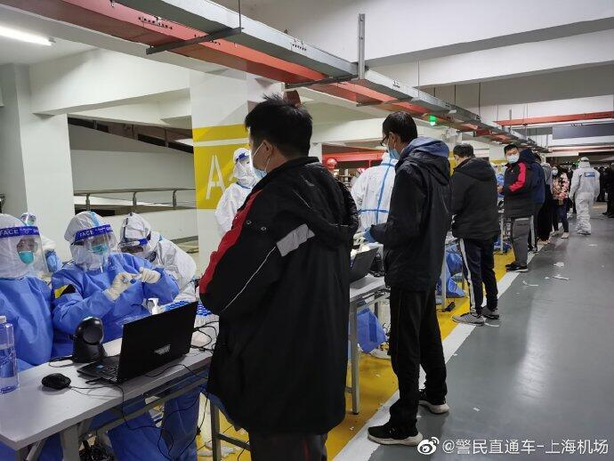 Cargo workers at Shanghai's Pudong airport line up for Covid-19 testing on November 22 after an evening of chaos.