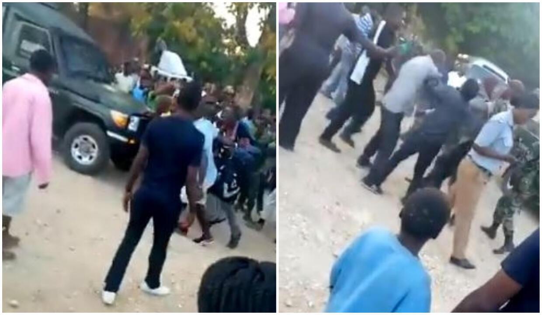 Des habitants de Nkhotakota prennent à partie des hommes suspectés d'être de faux observateurs de l'élection présidentielle, le 22 juin. Vidéo relayée sur Twitter.