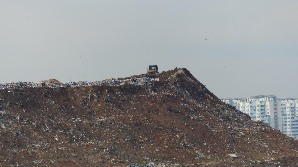 The landfill looms on the edge of the town, obstructing the view from people's houses.