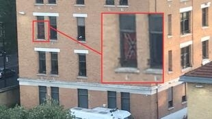 The recognisable Confederate flag displayed at the second-floor window of a building in the police barracks on Boulevard Bessières in Paris on June 30, 2020.