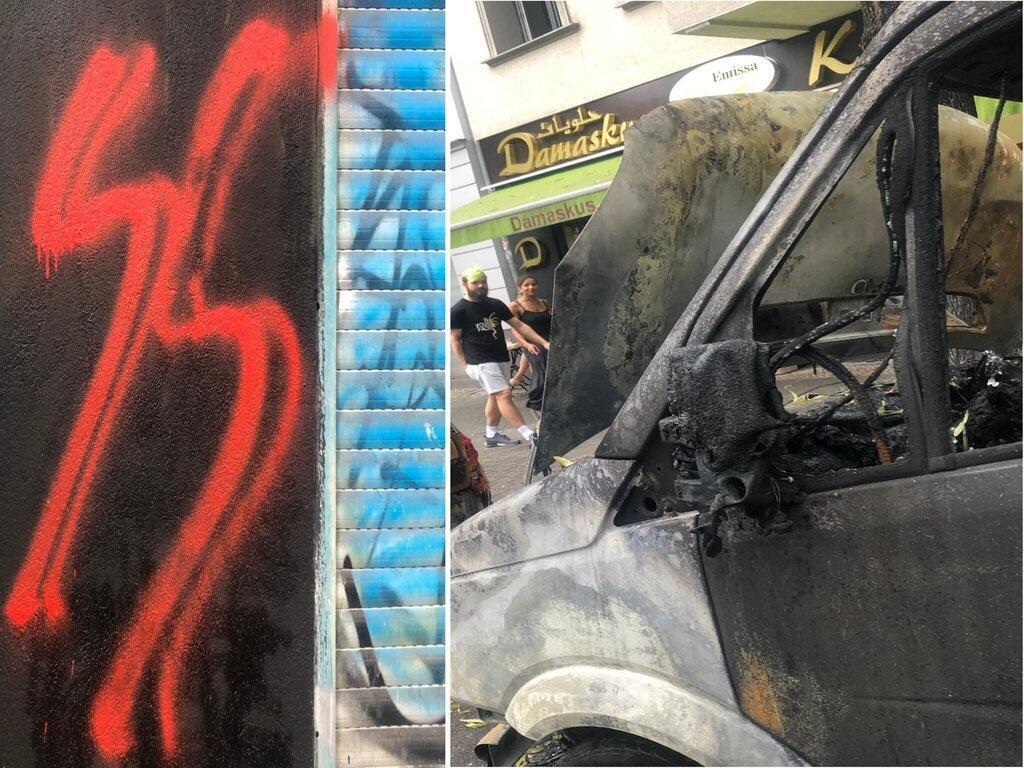 """على اليمين، سيارة متفحمة أمام مخبزة """"حلويات دمشق"""" التابعة للاجئ سوري في حي نويكولن. على اليسار، علامة وحدات ال""""أس أس"""" النازية شبه العسكرية على جدار نفس المخبزة."""
