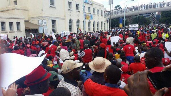 Protestors continue down Julius Nyerere Way in Harare, Zimbabwe on April 14, 2016. (Photo by Lynette N. Manzini)