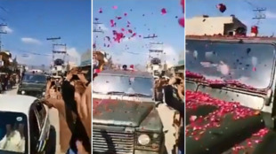 Villagers in Bhimber throw rose petals at the approaching Pakistani army convoy that has the captured Indian pilot.