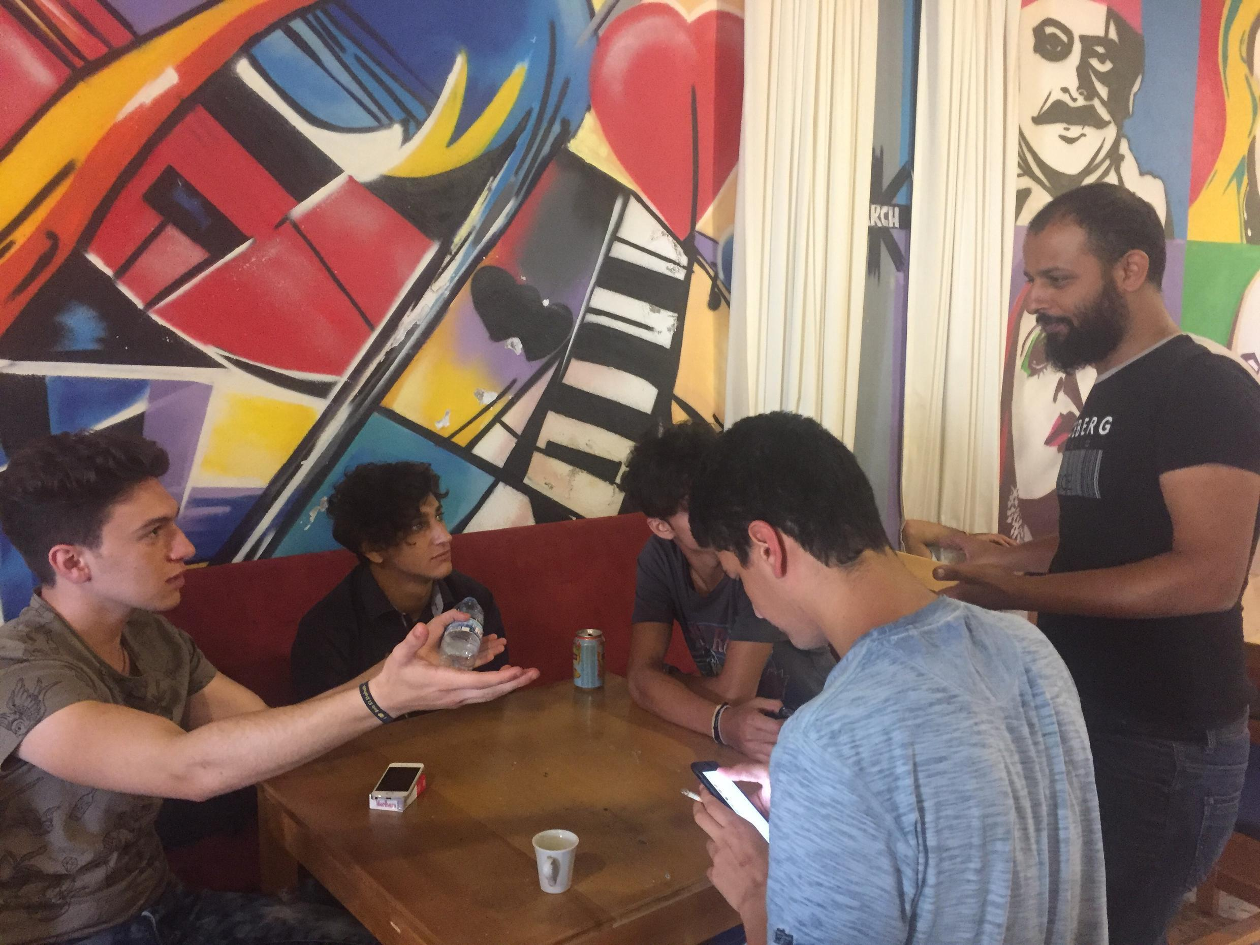 """At Kahwetna, which means """"our café"""", young people from historically divided neighbourhoods in Tripoli, Lebanon meet, talk to each other and come to find out how much they actually have in common with their so-called enemies."""