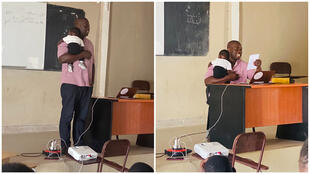 Labaly Toure, professeur de géomatique, portant le bébé d'une de ses élèves le 2 juin à Kaolack.
