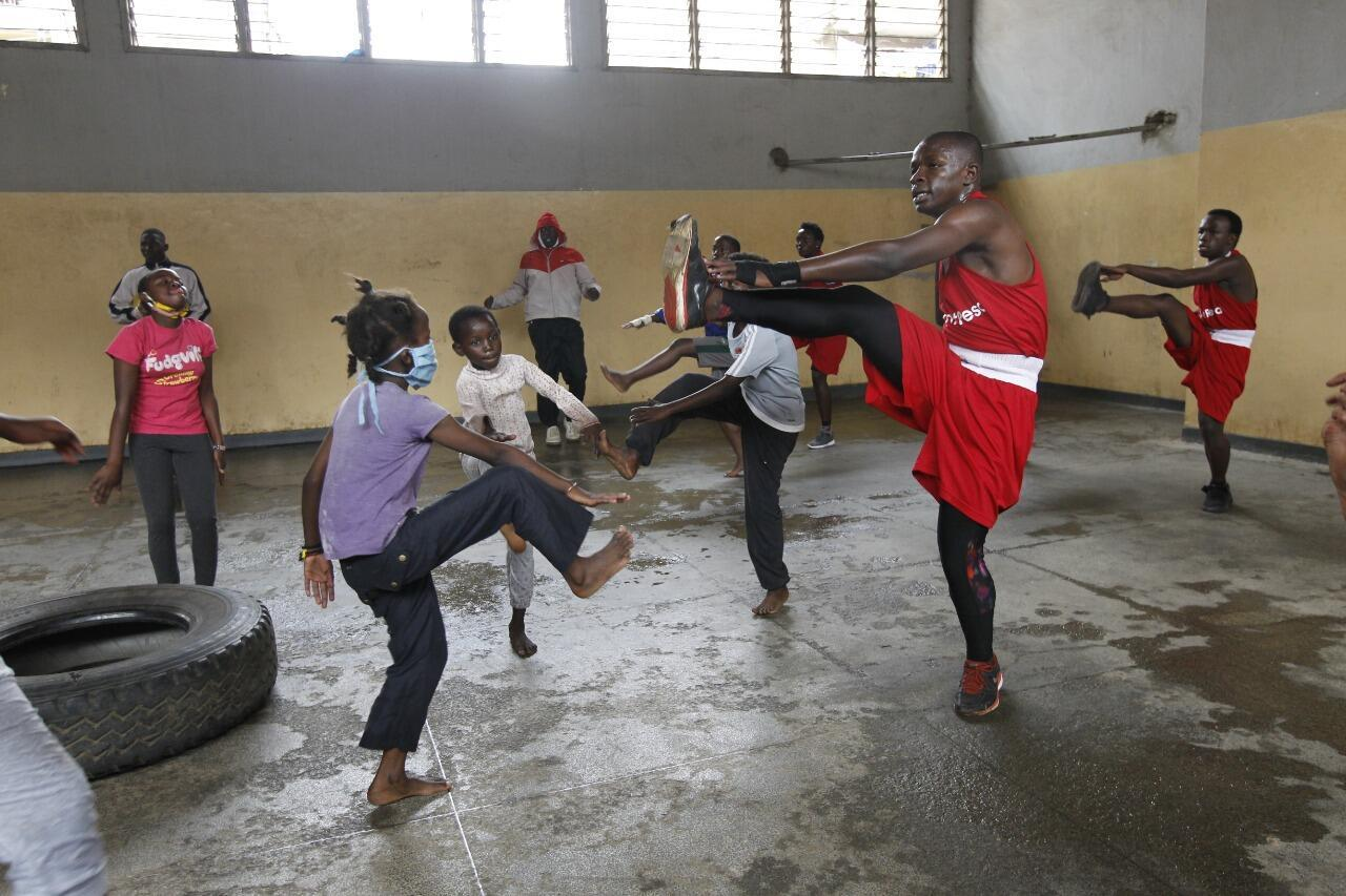 Students at Mathare North Boxing Club. Due to Covid-19, the club had to change the way training was carried out. Some students are seen with masks.