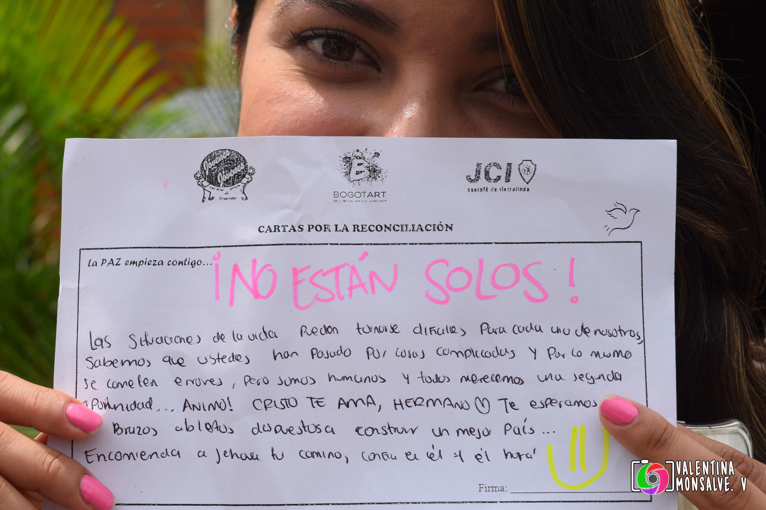 """One of the letters written to a FARC member. Across the top, it reads, """"You are not alone!"""""""