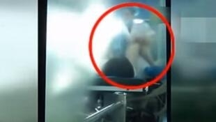 An amateur video filmed by a nurse shows a surgeon hitting a patient on the operating table.