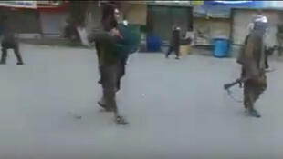 Taliban insurgents in the streets of Kunduz on Monday. Screen grab from the video below.