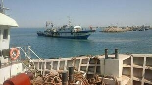 A photo posted by an Iranian fisherman shows a Chinese trawler in Iranian territorial waters.