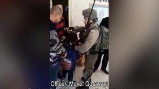 Screengrab of a video showing an Israeli officer arresting Yazan Idris in a school in Hebron, in the West Bank.
