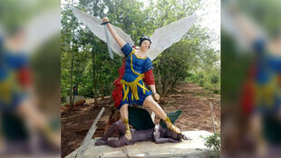 A statue of a white angel standing on a black demon on church grounds in southern Ghana was widely criticised by online users. (Photo: Yaw Amoffaya Antwi/Facebook)