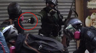 Screenshot from a video filmed Oct. 1, 2019 in Hong Kong showing a police officer firing a live round at a demonstrator. Source: Campus TV