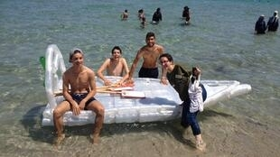 Young people from Maâmoura pose with the boat that they made out of recycled plastic bottles. (Photo posted on Facebook)