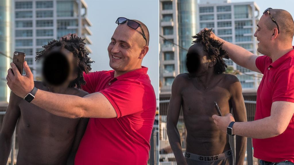 A man takes a selfie with another man while grabbing his hair in his fist. The photos caused an outrage on social media.