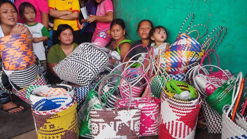This photo shows several Penan families and the baskets they've woven. Photo: Penan Bags Europe/Facebook