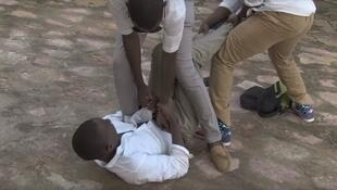In a short film produced at a workshop in Mali, a young homosexual man is roughed up during a reconstruction of the incident at his school. (Screen grab from the short film, below)