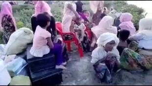 This screengrab is from a video purporting to show members of the Rohingya ethnic minority fleeing their villages (Video: Twitter)