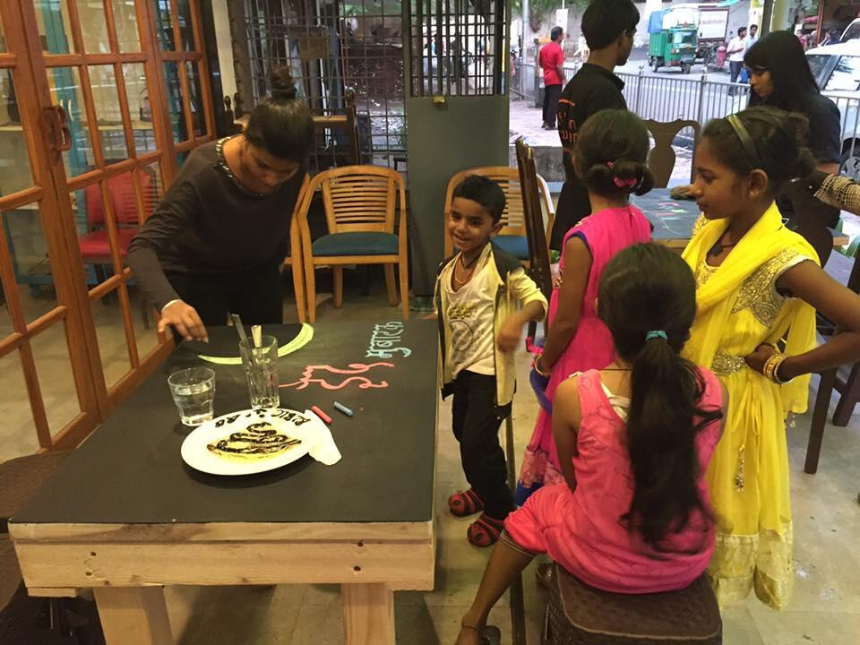 """Both children and adults visit Amin Sheikh's library café. All of the photos were published on the Facebook page """"Bombay to Barcelona Library Cafe""""."""