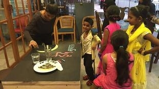 "Both children and adults visit Amin Sheikh's library café. All of the photos were published on the Facebook page ""Bombay to Barcelona Library Cafe""."