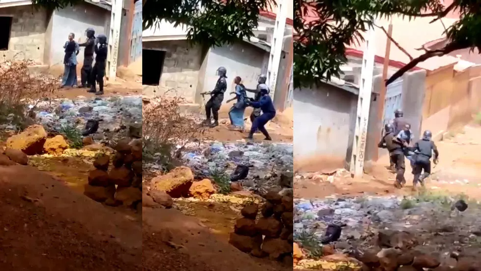 Screengrab from a video from Guinea showing police officers apparently using a woman as a human shield.