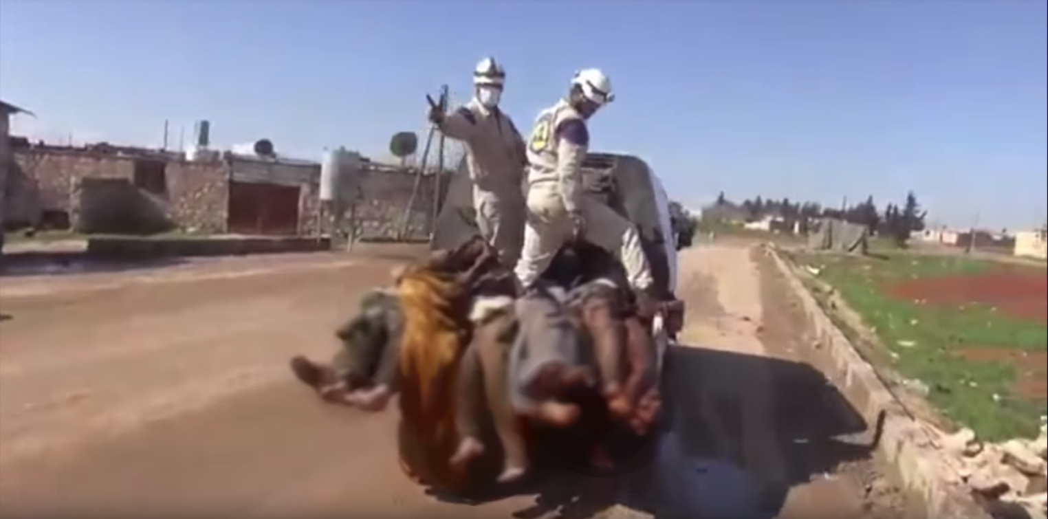 """Screen grab from a video that claims that White Helmets """"collaborate with armed groups""""."""