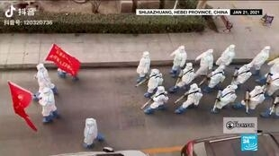 Hazmat workers disinfecting the streets of Shijiazhuang in Hebei province, China on January 21, 2021.