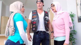 Screen capture from a porn clip with the American porn actress Mia Khalifa wearing the hijab, October 2014.