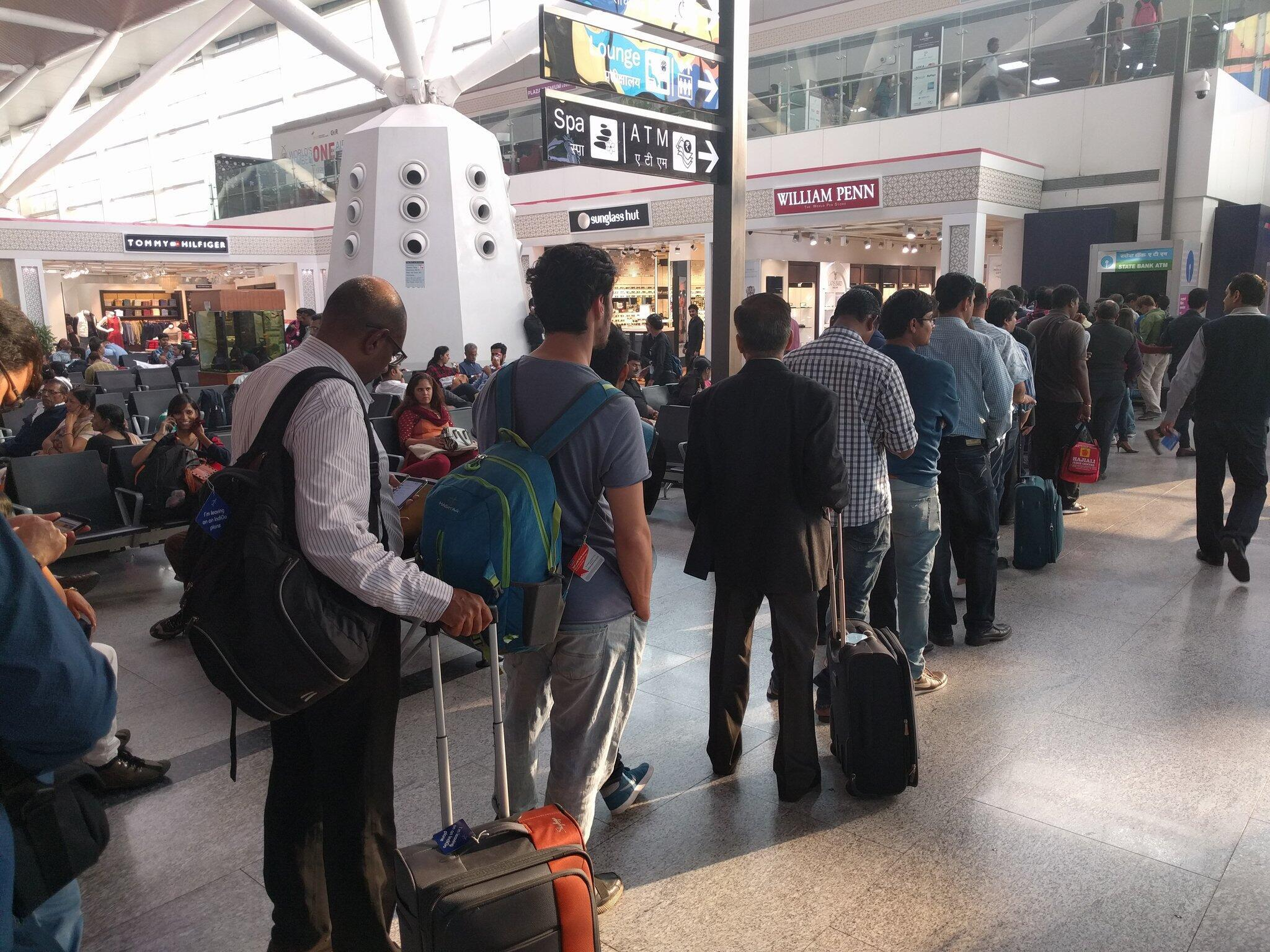 A long queue builds up at an ATM at an airport in Delhi.