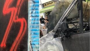 "Left: An ""SS"" graffiti tagged next to Damaskus Konditorei, a bakery founded by a Syrian refugee in Neukölln. Right: A charred vehicle outside of the bakery"