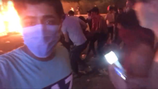 Protester Dhargham Zenki filmed a group of his fellow demonstrators carrying an injured man who he claims was shot.