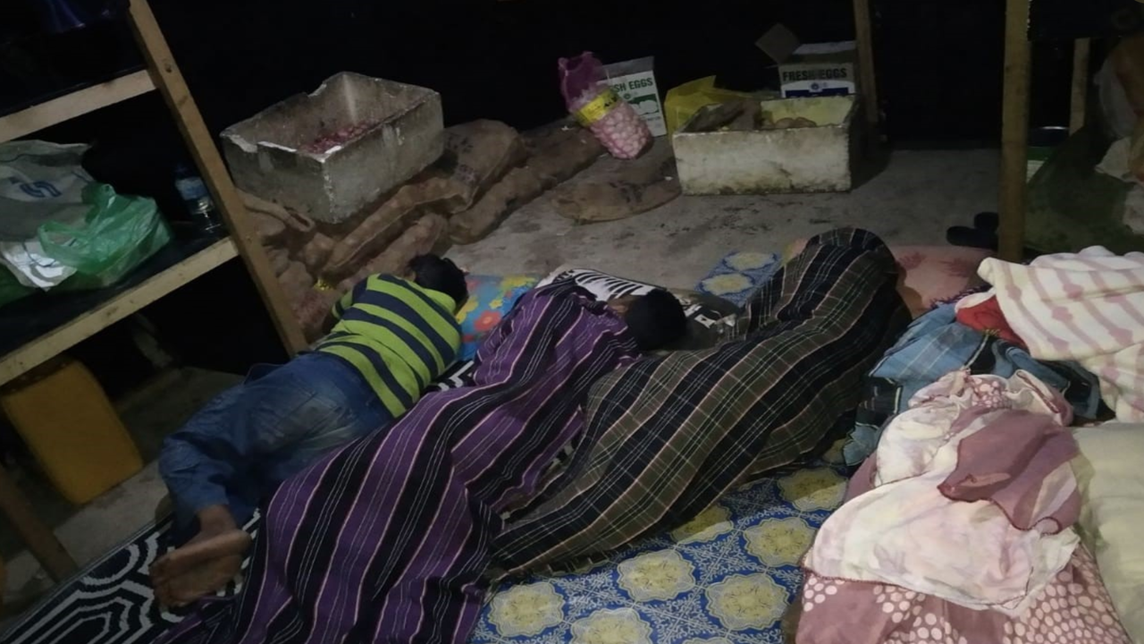 Migrant workers for the Bodufinolhu island development project sleep together on the floor