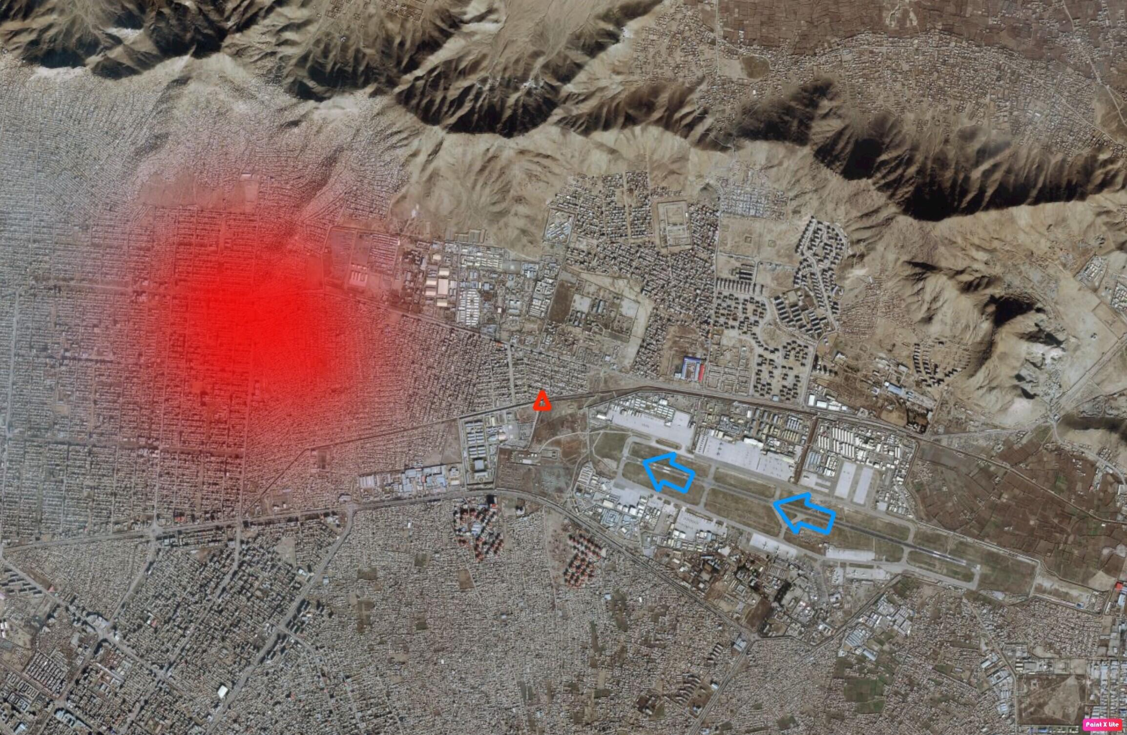 In this satellite image of the area surrounding Kabul airport, the blue arrows show the direction the US military plane took off in. The red triangle shows the location where the body of the first victim was found, and the area in red shows the approximate location where another victim's body was found on a rooftop.