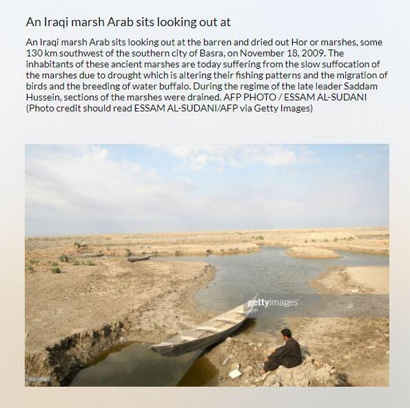 صورة ملتقطة من موقع تخزين الصور getty image ، تظهرا شخصا جالسا أمام بحيرة ملحية في منطقة الأهوار، بالعراق.