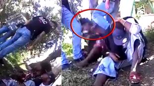 Un policier de la Brigade Anti-Criminelle (BAC) assène un violent coup de genou dans la tête d'un jeune homme qu'il est en train d'interroger à Nouméa.
