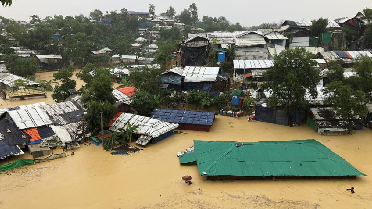 Heavy rains submerged shelters in some parts of the Cox's Bazar Rohingya refugee settlement on July 27.