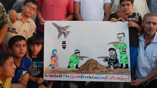 A photo of a cartoon published online by Raed Fares following the Russian strikes.