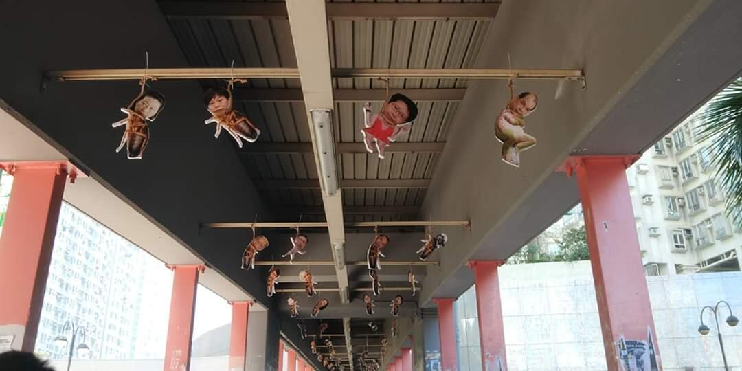 Protestors decorated a bridge in Hong Kong with ornaments featuring the heads of various members of the Hong Kong government transposed onto the bodies of cockroaches and suspended by fake nooses.