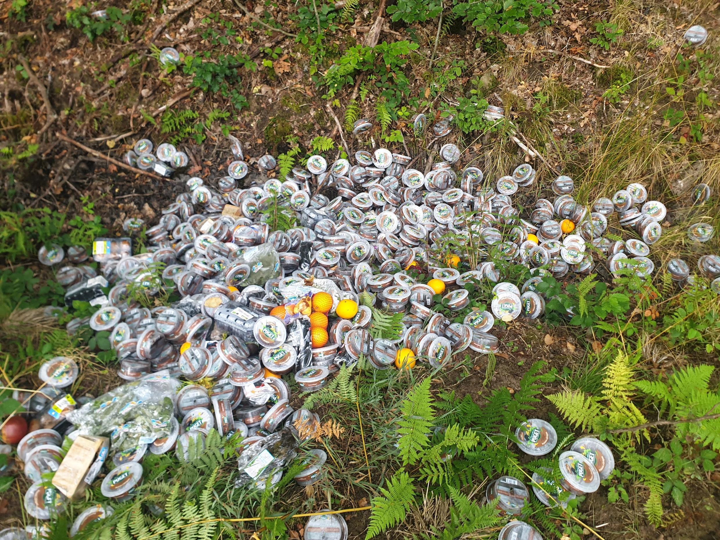 Piles of expired tapenade containers were found dumped in several different locations around northern France (Photo: Association Mormal Forêt Agir/Facebook)