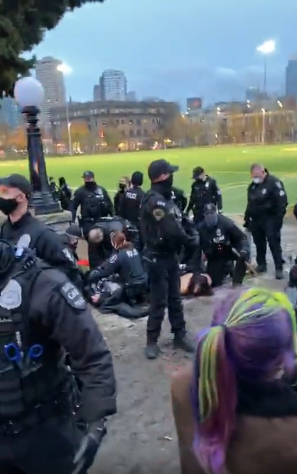 A screengrab from a livestream posted to Instagram on December 20 shows Seattle Police placing several individuals under arrest.