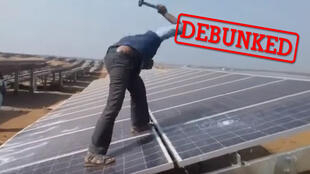 The video of these people destroying solar panels with hammers and sticks was shared online with a false caption. Source: Climate Samurai, YouTube